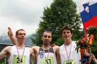 Tom Owens (2nd) and Robbie Simpson (3rd) with winner Mitja Kosovelj of Slovenia