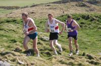 Chris Russell (Fife AC), Alex Jones (Fife AC) and the eventual winner Alasdair Anthony (Ochils) appoach the summit (Photo - Graham Bennison)